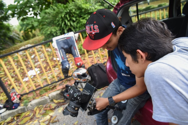 "Assessment time, our director and also test rider looking over some shots the team made during the MT-09 filming... A lot of ""ermpfhh"" and the ""okay lah"""